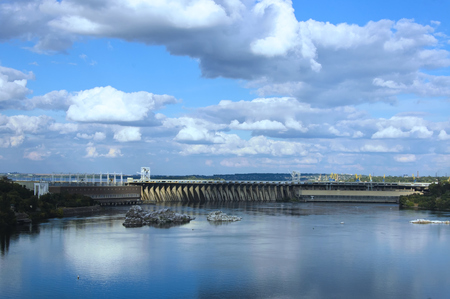 General view of Dniepe Hydroelectric Station at sunny day aganst the cloudy sky
