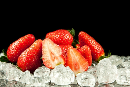strawberry on the ice on black background