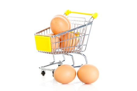 trolly: eggs and shopping trolly isolatedon white background