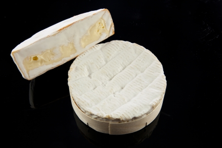 ripened: camambert cheese on black background