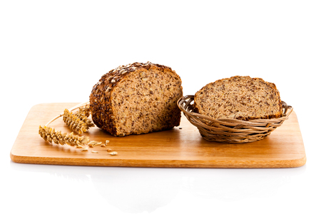 Brown seed biobread isolated on white background Stock Photo