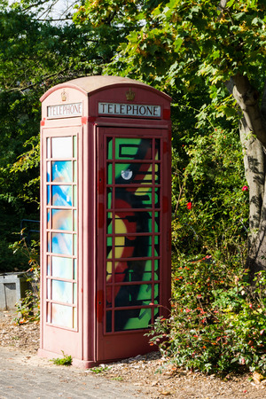 payphone: painted old red phone booth, phone box, painted in different colors, london