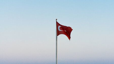 turkish ethnicity: flag of Turkey on blue sky