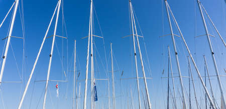 mast: mast against a blue sky, ship mast, marina in European city, the Adriatic sea