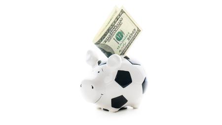 us dollars: one hundred US dollars in Piggybank isolated on white background. bucks