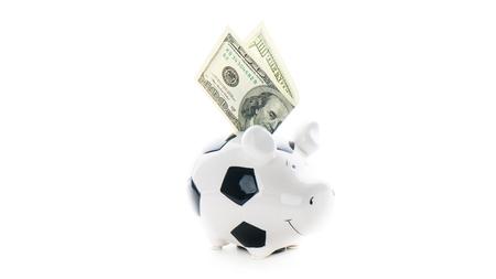 one hundred US dollars in Piggybank isolated on white background. bucks
