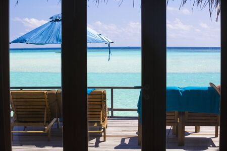 View from the inside of the bungalow through the window in The Maldives.