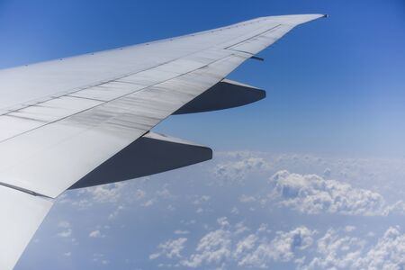 View from the right side of an aircraft of the wing, the plane is ready to land.