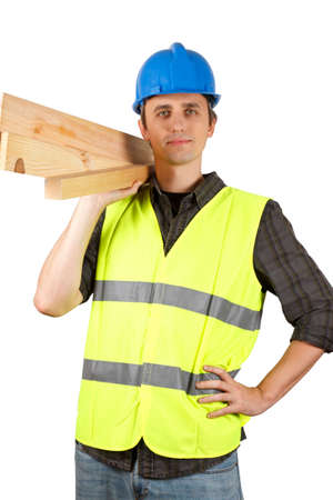 Homme travailleur tenant des planches. Plus de blanc. Banque d'images