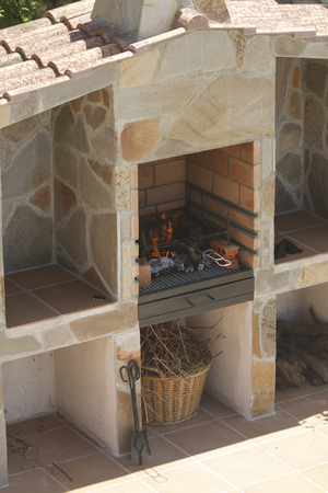 Built in stone construction barbecue for outdoors. Stock Photo