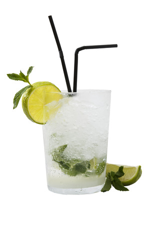 Mojito with mint leaves and ice. Over white.