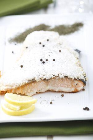 Salt-roast salmon with lemon and dill.