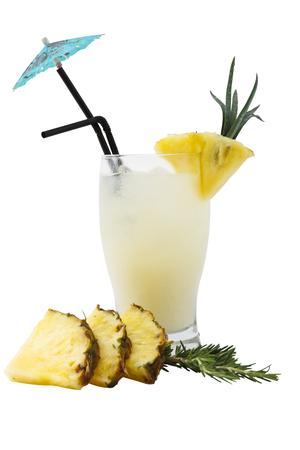 Delicious pi–a colada with pineapple and umbrella. Over white.