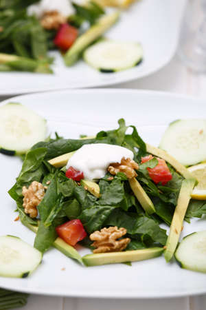 Spinach salad with lox and avocado. Stock Photo