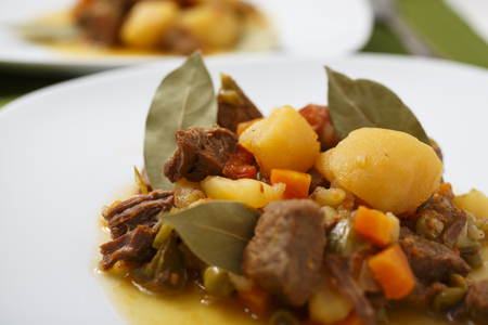 Beef stew with potatos and carrots.