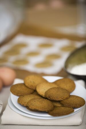Plate with cookies in the table at front. Stock Photo