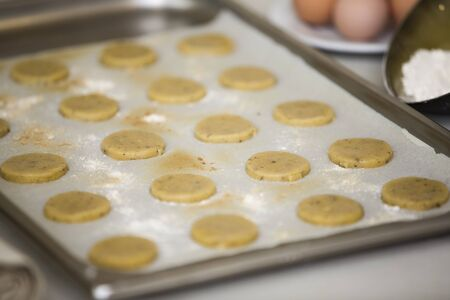 Fresh macadamia nut cookies in a tray ready to bake.