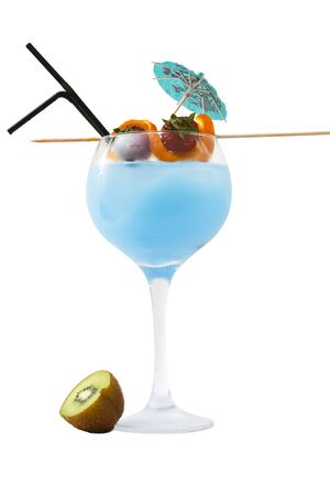 Cold blue drink with fruit and straws.