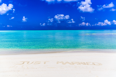 Message of just married written on sand in Maldives.