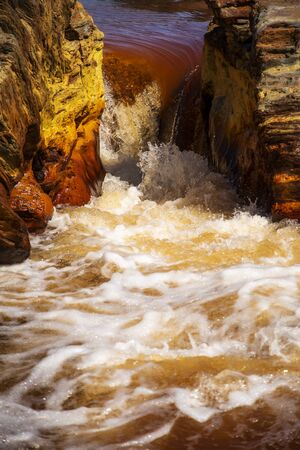 Beautiful landscape in Huelva, Rio Tinto, small cascade with water flowing 스톡 콘텐츠
