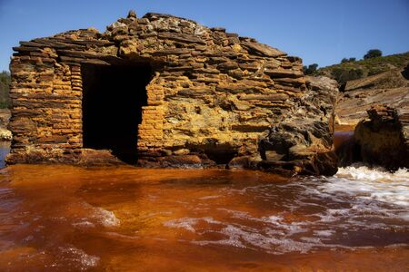 Beautiful house made out of stones in the middle of rio Tinto, Huelva. 스톡 콘텐츠