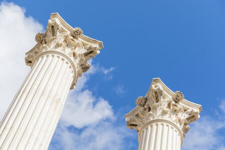 corinthian columns style reaching out for the sky in outdoors.