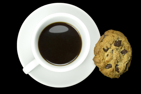 coffee and cookies isolated on a black background photo