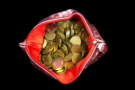 spending full: Russian coins  in a red purse arranged on a black background Stock Photo