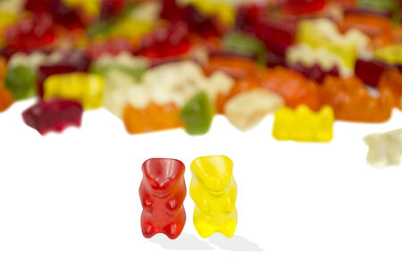gummie: red and yellow bears with other multi colored gummy Bears isolated on white Stock Photo