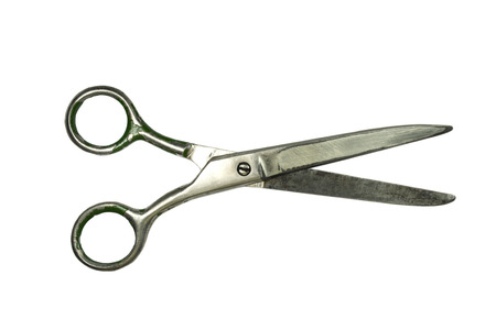 Old scissors isolated on a white background photo