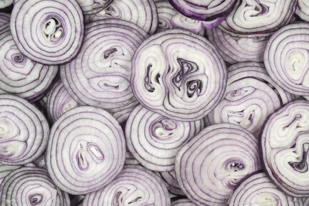 This background consists of sliced ​​red onions photo
