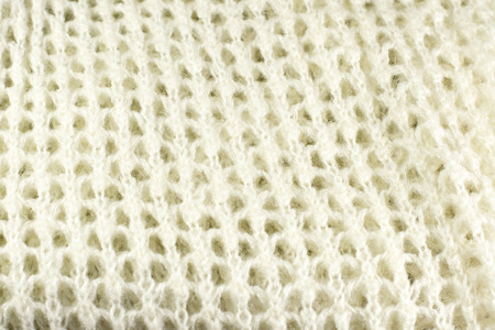 woolen: knitted woolen fabric close up as background Stock Photo
