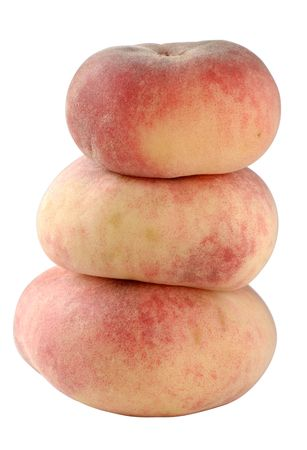 A stack of three flat &quot,Doughnut&quot, peaches,