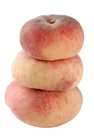 A stack of three flat &quot,Doughnut&quot, peaches, Shallow DOF with focus on the center of the upper peach and the side of the lower one.  Stock Photo