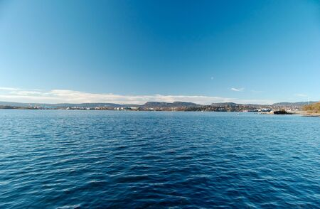 Fish-eye view over Oslo Fjord, looking at Byg�y and Fornebu. Sky and water are filter-polarised.