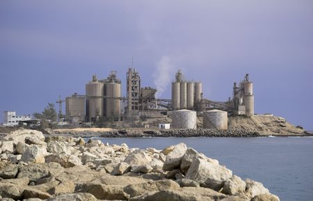 A cement factory, located on the coast, near Arguineguin, Gran Canaria   Stock Photo