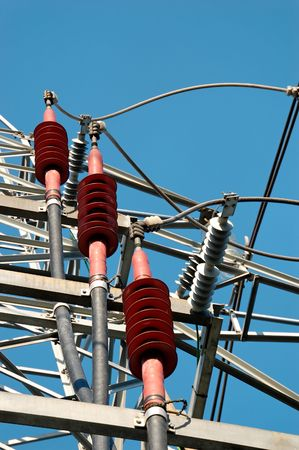 Three red ceramic high-voltage power line fixtures for grounding of the cables   Stock Photo