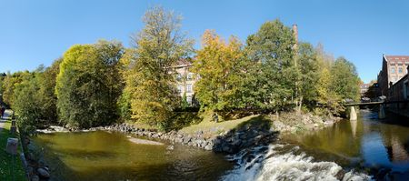 180 degree panoramic view of Akerselva river and Nydalen old industry park in Oslo, Norway during the height of autumn. The image is composed of 9 individual shots.