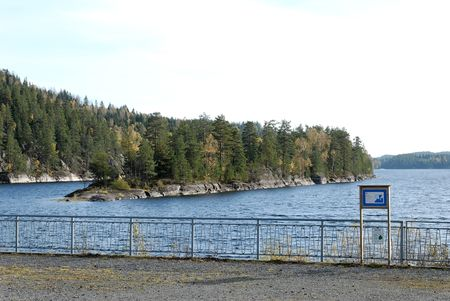 The dam rail and Elvåga lake in the background. This lake supplies Oslo with drinking water.   Stock Photo