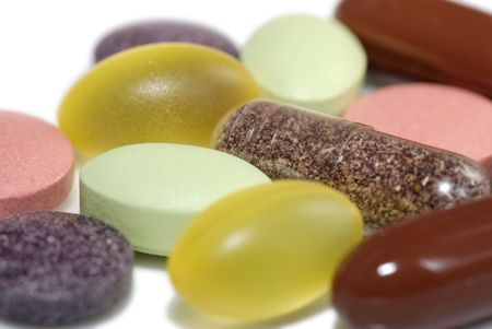 Several vitamin pills and capsules   Stock Photo
