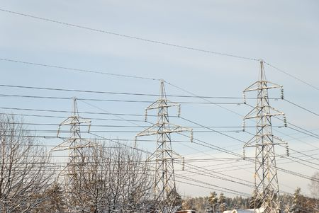 Snow covered pylons and powerlines.