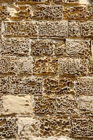 Eroded sandstone wall of St.James Cavalier in Valletta, Malta   Stock Photo