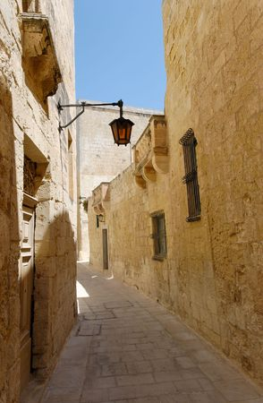 The empty silent narrow street of the Silent City - Mdina on Malta.