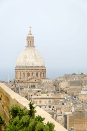 The dome of Our Lady of Mount Carmel church in Valletta, Malta. Photographed from a rooftop.   Stock Photo
