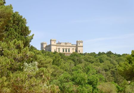 Verdala Palace on Malta, seen through the green of the small forest - Buskett