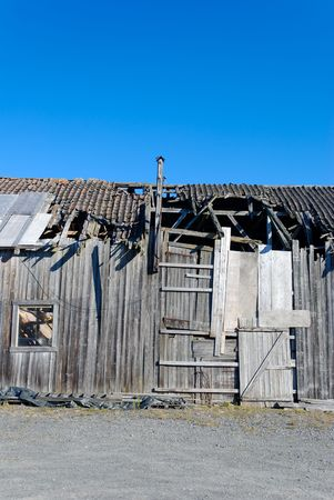 A detail of an old abandoned barn in rural Norway. Stock Photo - 3571314