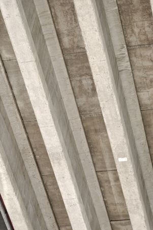 Underside of a highway bridge, forming abstract concrete stripes.