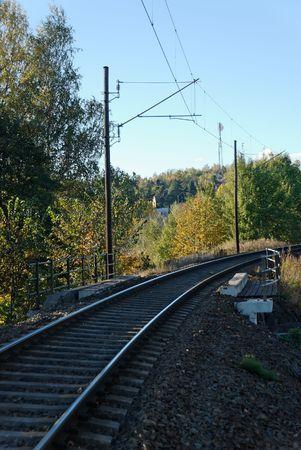Single line railway track in autumn.