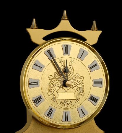 Clock dial showing five minutes to twelve. Stock Photo