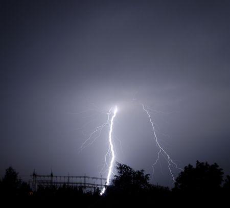 Lightning striking at a power station.